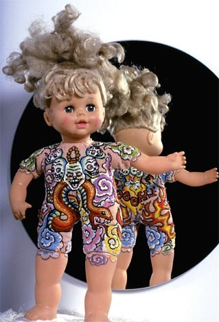 I find cloth bodied baby dolls at thrift shops and send them to tattoo